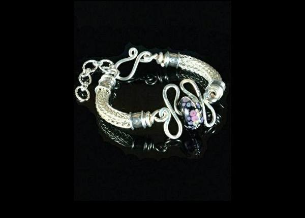 #1308 ~ Sculptured Bracelet of Woven Silver Rope with a Casa Grande Amber Lamp Work Bead